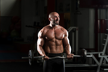 Mature Man Exercise With Barbell
