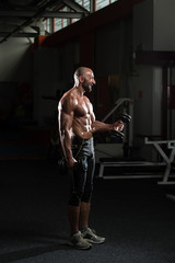 Mature Man Exercise With Dumbbell