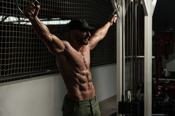 Mature Bodybuilder Is Working On His Chest