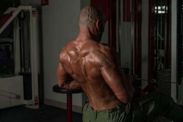 Healthy Mature Man Doing Exercise For Back
