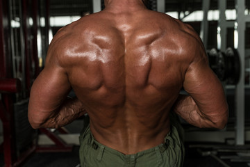 Mature Bodybuilder Doing Heavy Weight Exercise For Back