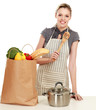Woman with shopping bags in the kitchen at home