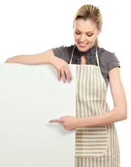 Happy woman in apron holding sign billboard