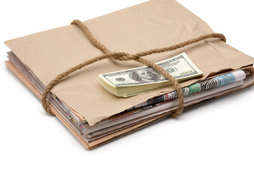 newspaper stack and dollars