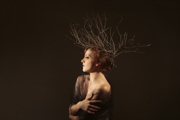 Woman With Branches as a Creative Head Piece