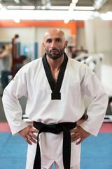 Portrait Of A Man In Kimono With Black Belt