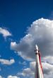 white rocket on blue sky background
