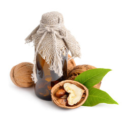Walnut with pharmaceutical bottle isolated