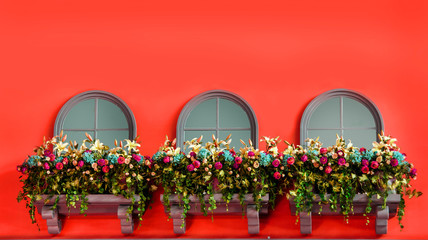windows and Flowers on the balcony of red pannel