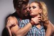 sexy muscular man embracing his girlfriend