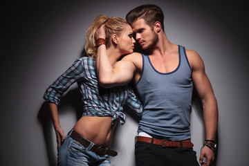 man embracing woman and reveals his biceps