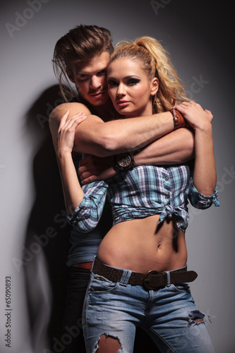 man and woman standing embraced