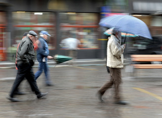 People walking down the street on rainy day