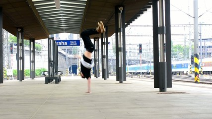 Breakdancer dancing breakdance at the train station in Prague