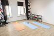Gym with mats and exercising materials prepared for yoga