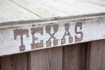 Texas words on wooden planks