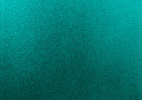 Turquoise frosted glass texture as background