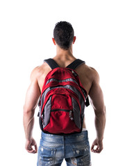 Back of muscular young man with backpack