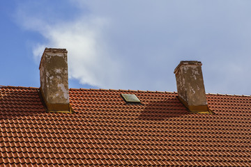 Crest tile roof with chimneys