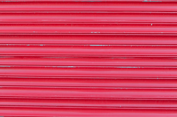 Weathered red shutters at seaside
