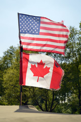 National flags of USA and Canada on one flagstaff