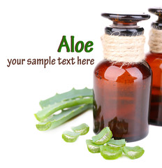 Fresh green aloe leaves and medicine bottles, isolated on white