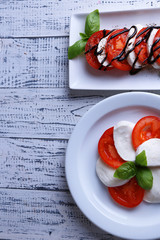 Caprese salad with mozarella cheese, tomatoes and basil