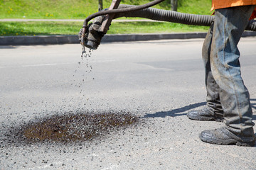 Construction Worker during Pothole Repair