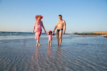 Huppy family on beach in Persian Gulf ,Dubai. Tanning near ocean