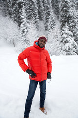 African American Cheerful black man in ski suit