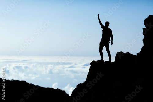 Hiking success silhouette, man trail runner in mountains - 65096850