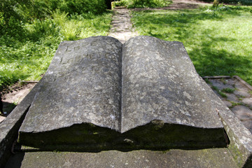 Old carved stone book