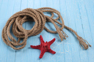 rope  starfish on blue  background