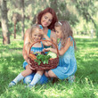 Mother with two daughters in the park