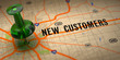 New Customers - Green Pushpin on a Map Background. - 65099269