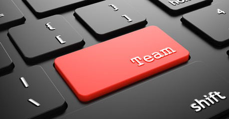 Team on Red Keyboard Button.