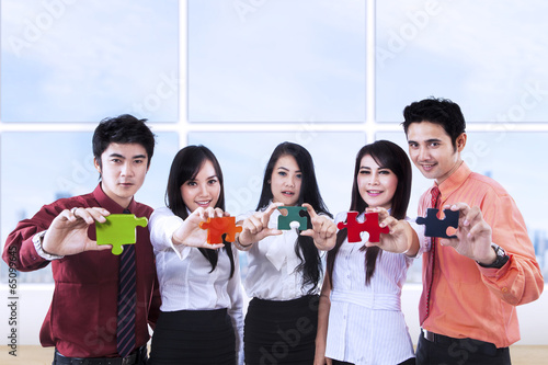 Business teamwork and puzzle pieces
