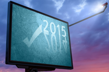 Billboard at sunset with a text message for 2015