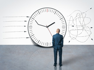 man looking at the delay clock and time management on the wall