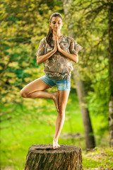 Young attractive woman doing yoga in nature.