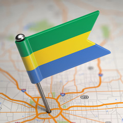 Gabon Small Flag on a Map Background.