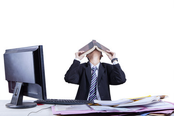 Exhausted businessman covering his face