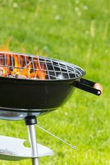 Empty burning grill on garden
