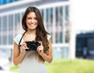Young smiling photographer