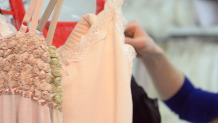 Young beautiful woman chooses underwear at the mall.