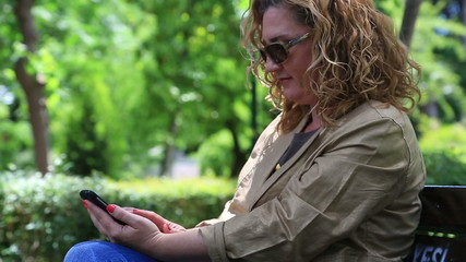 Woman Using a Smartphone in park