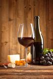 Wine still life on wooden planks