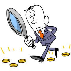 ビジネスマンと虫眼鏡とコイン