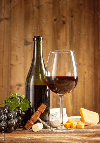 Wine still life on wooden planks