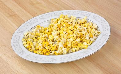 Platter of popcorn on tabletop